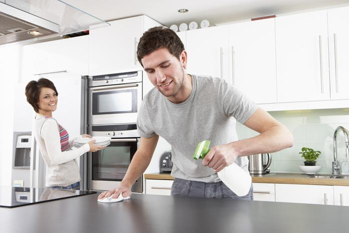 Man cleaning cleaning kitchen